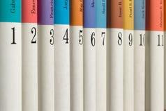 Libri numerati in una fila fotografie stock