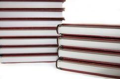 Libri su una priorità bassa bianca Fotografia Stock Libera da Diritti