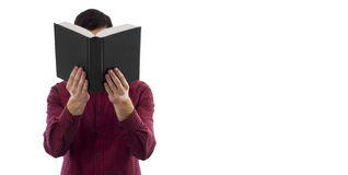 Libro abierto de la tenencia del hombre aislado en blanco Fotografía de archivo