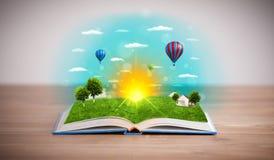 Libro aperto con il mondo verde della natura che esce dalle sue pagine Fotografia Stock