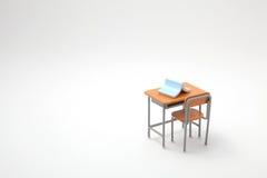 Libro azul y escritorio de aprendizaje miniatura imagen de archivo libre de regalías