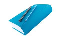Libro azul y etiquetas de plástico Fotografía de archivo libre de regalías