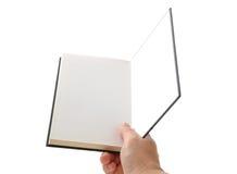 Libro in bianco aperto della mano Immagini Stock
