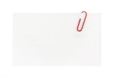 Libro Blanco y clip con el camino de recortes Fotos de archivo