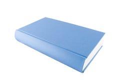 Libro blu chiuso isolato su una priorità bassa bianca Fotografia Stock Libera da Diritti
