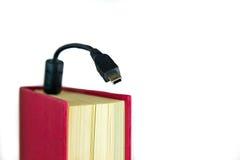 Libro con el mini USB Imagen de archivo
