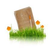 Libro con la flor y la hierba Imágenes de archivo libres de regalías
