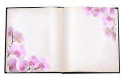 Libro con la imagen de la orquídea imagen de archivo libre de regalías