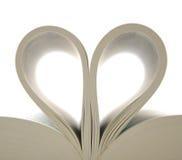 Libro con las paginaciones abiertas y la dimensión de una variable del corazón Imagen de archivo