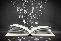 Libro con le lettere fotografia stock libera da diritti