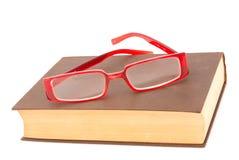 Libro con los vidrios Foto de archivo