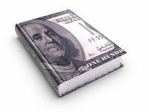 Libro cubierto con 100 dólares americanos.