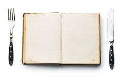 Libro d'annata e coltelleria fotografia stock libera da diritti
