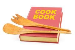 Libro de cocina y utensilios de cocina fotografía de archivo libre de regalías