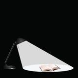 Libro de la lámpara de escritorio Imagenes de archivo