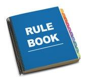 Libro de la regla foto de archivo