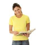 Libro de lectura adolescente de la mujer Imagen de archivo