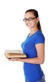 Libro de lectura adolescente de la mujer Imagen de archivo libre de regalías