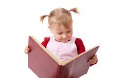 Libro de lectura de la niña imagen de archivo
