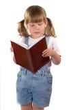 Libro de lectura de la niña fotografía de archivo libre de regalías