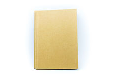 Libro de papel de Brown aislado en el fondo blanco Imagen de archivo