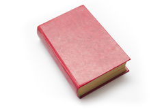 Libro de tapa dura rojo en blanco en el fondo blanco con el espacio de la copia Imagen de archivo libre de regalías