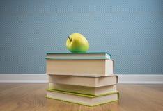Libro de texto con la manzana amarilla Fotos de archivo