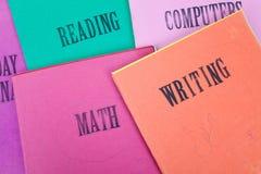 libro de texto de la matemáticas y de la escritura fotos de archivo libres de regalías