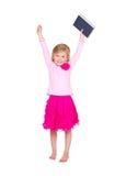 Libro del asimiento del niño sobre la cabeza Imagen de archivo libre de regalías