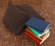 Libro del cuscino sul pavimento di legno Fotografie Stock