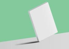 Libro del modello isolato su un fondo verde e grigio Fotografia Stock