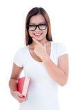 Libro della holding della giovane donna di Atractive fotografia stock libera da diritti
