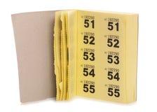 Libro di biglietto giallo di raffle immagini stock