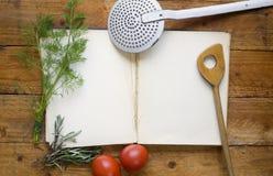 Libro di cucina vuoto, fotografie stock