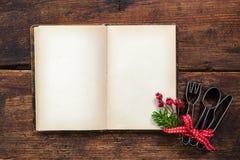 Libro di cucina vuoto per le ricette di Natale immagine stock