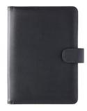 Libro di cuoio nero della copertura isolato su bianco Fotografia Stock
