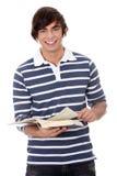 Libro di lettura del giovane Immagini Stock