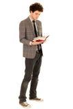 Libro di lettura del giovane Fotografia Stock