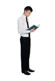 Libro di lettura dell'uomo di affari Immagine Stock
