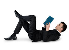 Libro di lettura dell'uomo di affari giù Fotografie Stock
