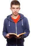 Libro di lettura teenager Fotografia Stock