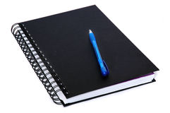 Libro di scrittura e penna blu Fotografia Stock