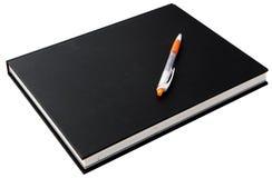 Libro e penna Fotografie Stock