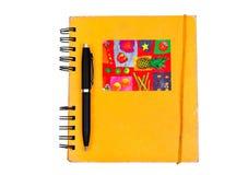 Libro e penna arancio Fotografia Stock