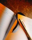 Libro e penna di ospite Fotografie Stock