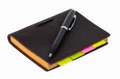 Libro e penna isolati Fotografia Stock