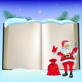 Libro ed il Babbo Natale aperti di natale Fotografia Stock Libera da Diritti