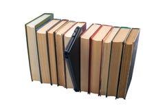 Libro elettronico contro i vecchi libri Fotografie Stock