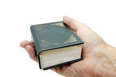 Libro en la palma Fotografía de archivo libre de regalías