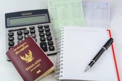 Libro, pasaporte y calculadora de la cuenta bancaria Imagen de archivo libre de regalías